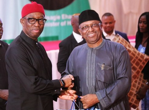 Delta State Governor, Senator Dr. Ifeanyi Okowa (left) presenting a gift to the Hon. Minister of Health Federal Republic of Nigeria, Dr. Osagie Ehanire, during the State Banquet, in Hounor of Delegates to the national Council of Health, held at Dome Event Centre Okpanam Road, Asaba Delta State.