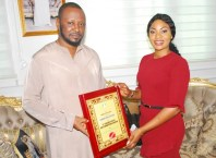 Comrade Prince Kpokpogri being presented with NANFS Award of 21st Century Icon of Anti-Corruption in Nigeria by Comrade Joan Obi