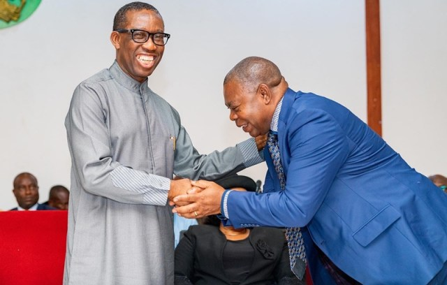 Delta Governor, Sen. Dr. Ifeanyi Okowa, congratulating Mr. Monday Onyeme shortly after being sworn-in as Chairman, Delta state Board of Internal Revenue at the Government House, Asaba