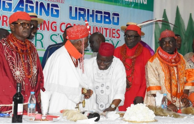 DESOPADEC Managing Director, Chief Askia Ogieh exchanging pleasantries with Urhobo Monarchs during the DESOPADEC Town hall meeting with Urhobo Ethnic Nationality