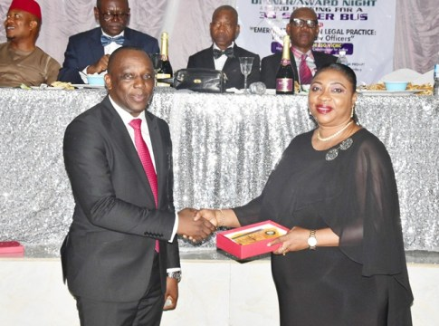 Delta Attorney General, Mr Peter Mrakpor receiving an award on behalf of His Excellency, Delta Governor, Senator Dr. Ifeanyi Okowa during LOAN's award. The award was presented by the representative of the State Chief Judge, Justice M.O Omovie on behalf of Law Officers Association of Nigeria