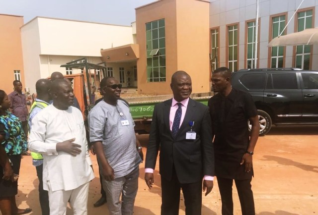 Chairman, Delta State House of Assembly Committee on Housing and Women Affairs, Hon Ferguson Onwo (In Suit) and State Commissioner, Ministry of Housing, Chief Festus Ochonogor (left) during an on the spot assessment of ongoing work at Appeal Court Complex