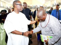 Delta State Governor, Senator Dr. Ifeanyi Okowa (left) in a warm handshake with Bashorun Askia Ogieh during his (Ogieh's) Thanksgiving Mass at St. Matthias Catholic Church, Uzere on Sunday, January 26, 2020