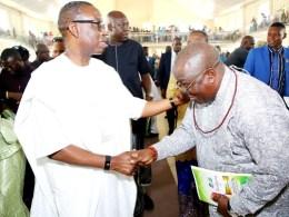 Delta State Governor, Senator Dr. Ifeanyi Okowa (left) in a warm handshake with Bashorun Askia Ogieh during his (Ogieh's) Thanksgiving Mass at St. Matthias Catholic Church, Uzere on Sunday, January 26, 2020