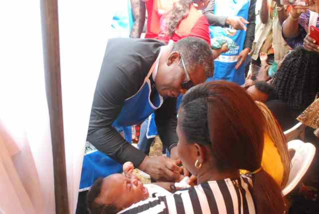 Delta State Commissioner for Health, Dr Mordi Onoye administering the Polio Vaccine to a Baby during the flag-Off of the Sub-National Immunization Plus Days in the State
