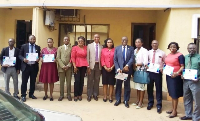 Top Management Staff of Delta State Primary Health Care Development Agency, and the Awardees in a group Photograph
