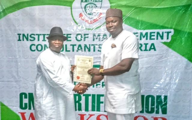 Former Minister of Education, Prof Jerry Agada (left), presenting Certificate of Fellowship to Mr. Iteveh Ekpokpobe.