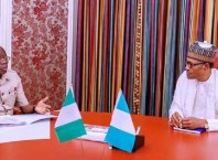 R-L: President Muhammadu Buhari and Comrade Adams Oshiomhole