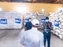A Backshot of Delta Governor, Senator Dr. Ifeanyi Okowa while inspecting food items stored at the State's Food Bank at Ibusa on Thursday, April 16, 2020 (Source: Twitter)