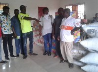 Engr Isaac Omafuaire Presenting Food Items to Olomu Communities