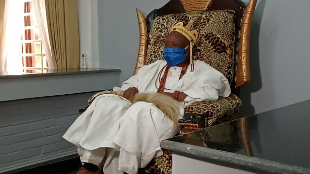 HRM Raphael Agbamuche, Obi of Onicha-Uku sitting on the throne in the newly built palace