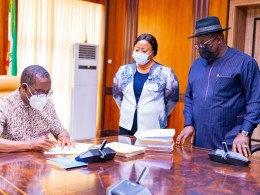 L-R: Delta Governor, Senator Dr Ifeanyi Okowa signing into law the bills formally establishing the three newly approved universities in the State as passed by the House of Assembly, while the Clerk of the House, Mrs. Lyna Ocholor and the Speaker, Rt .Hon . Sheriff Oborevwori look on in Government House, Asaba on Thursday, February 25, 2021.(Pix Yinka Oladosun)
