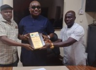 FUPRE Vice Chancellor, Prof. Akpofure Rim-Rukeh (Middle), Mr. Gabriel Ejoba, PG, Ugbomro Community (Left) and Chief Ikpi Bernard (Right) during a presentation of trophy to the VC.