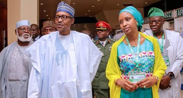File Photo: (L-R) President Muhammadu Buhari and Hadiza Bala Usman