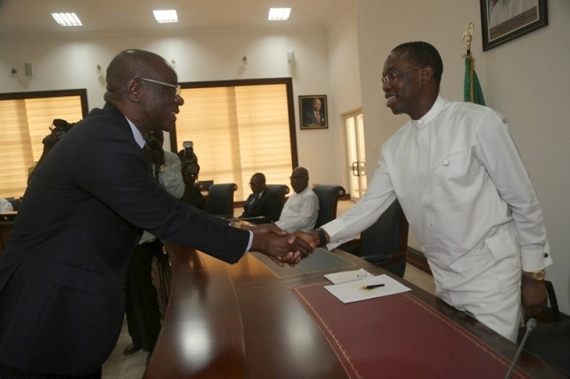 Delta Governor, Ifeanyi Okowa and Justice Vincent Ofesi Shaking Hands after Justice Ofesi's Inauguration as a Judge of the Delta State High Court on January 18, 2017