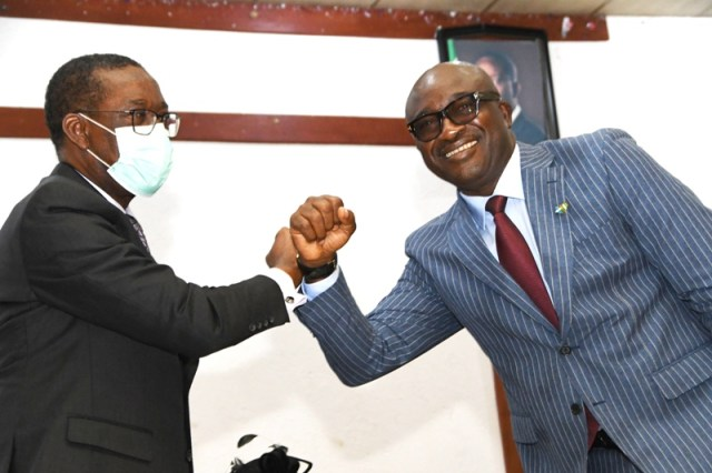 Delta Governor, Senator Dr. Ifeanyi Okowa (left), congratulating Chief Patrick Ukah shortly after his inauguration as the Secretary to Delta State Government (SSG) in Asaba on Monday, June 7, 2021. (Pix: Bripin Enarusai)