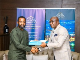 Secretary to Delta State Government, Chief Patrick Ukah (right) performing the formal handing over of Asaba International Airport to the Chairman, Asaba Airport Company, Mr. Bisi Adebutu in Asaba on Monday, August 23, 2021