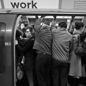 City workers cram into tube carriage.