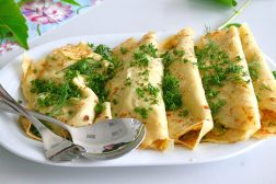A row of rolled savory pancakes