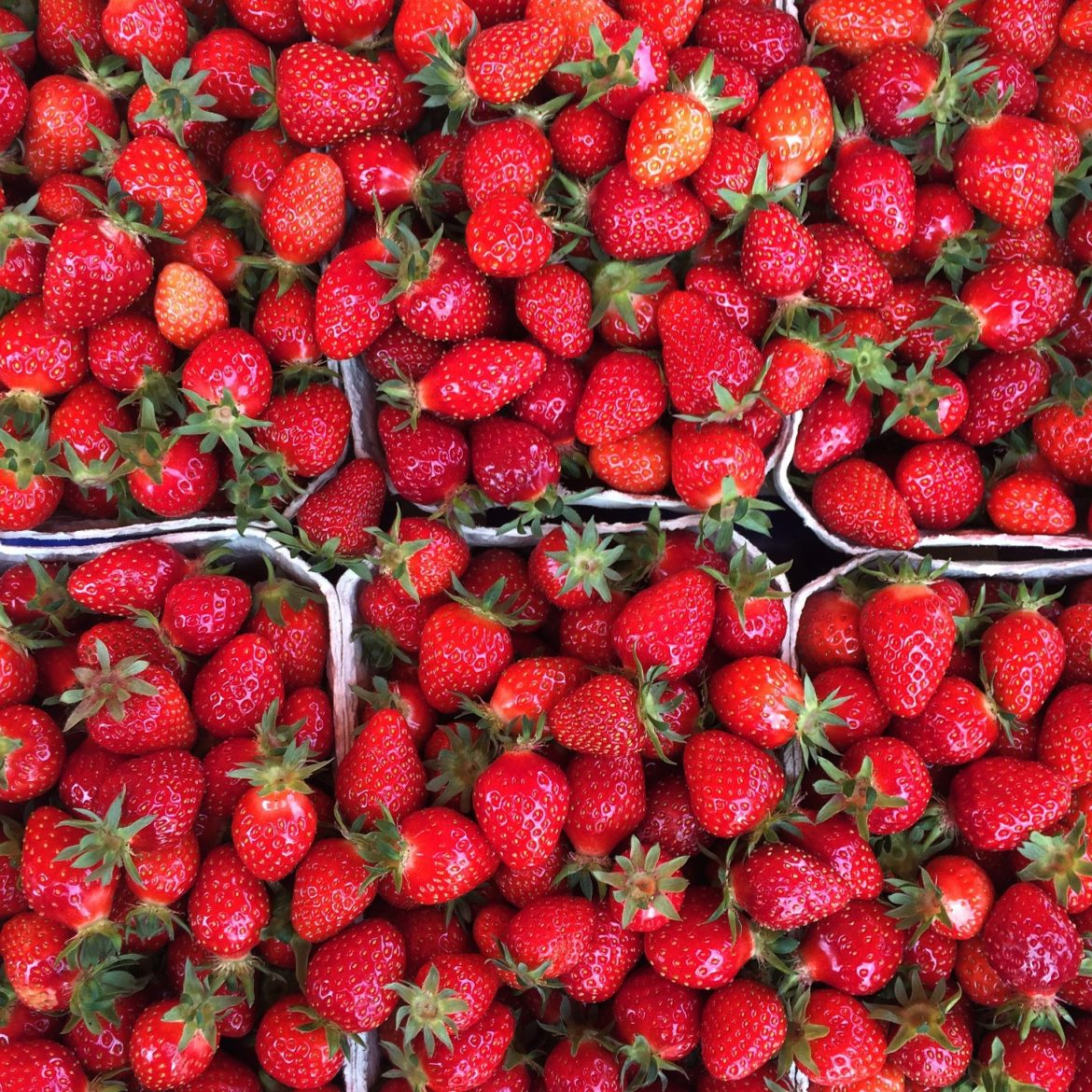Punnets of fresh strawberries from above