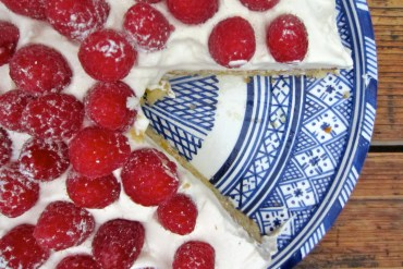 Cake on a plate with raspberries