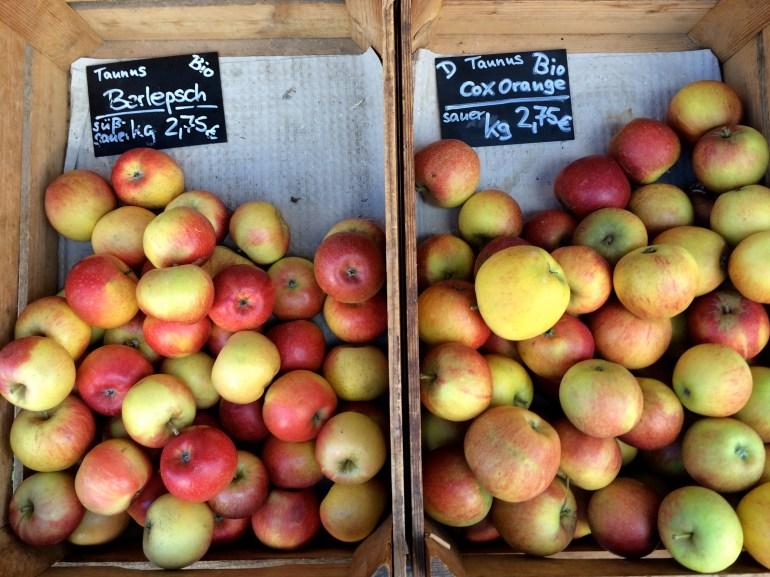 Two half-empty crates of German apples