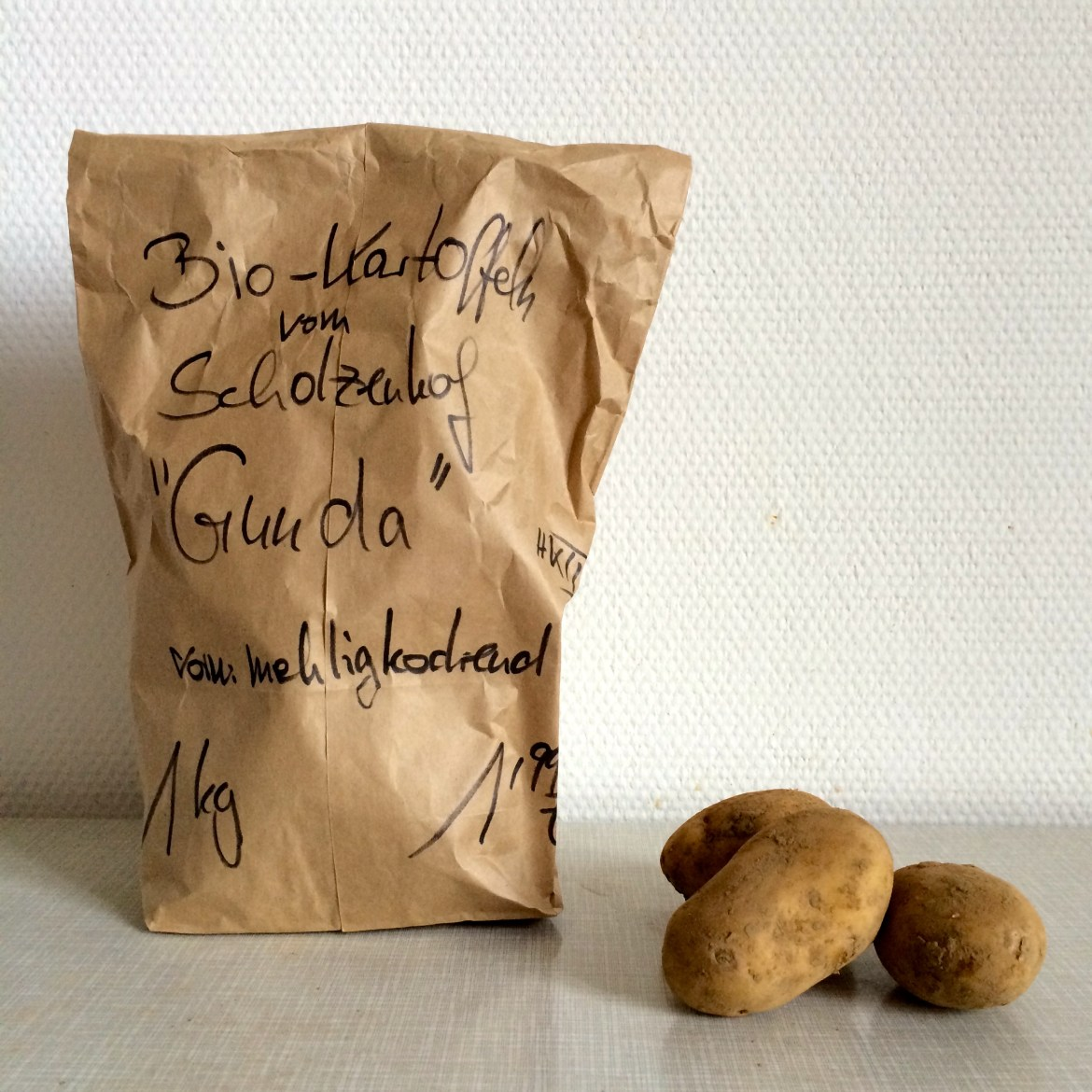 Brown paper bag of potatoes