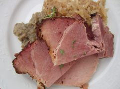 Slices of ham with cabbage and potato