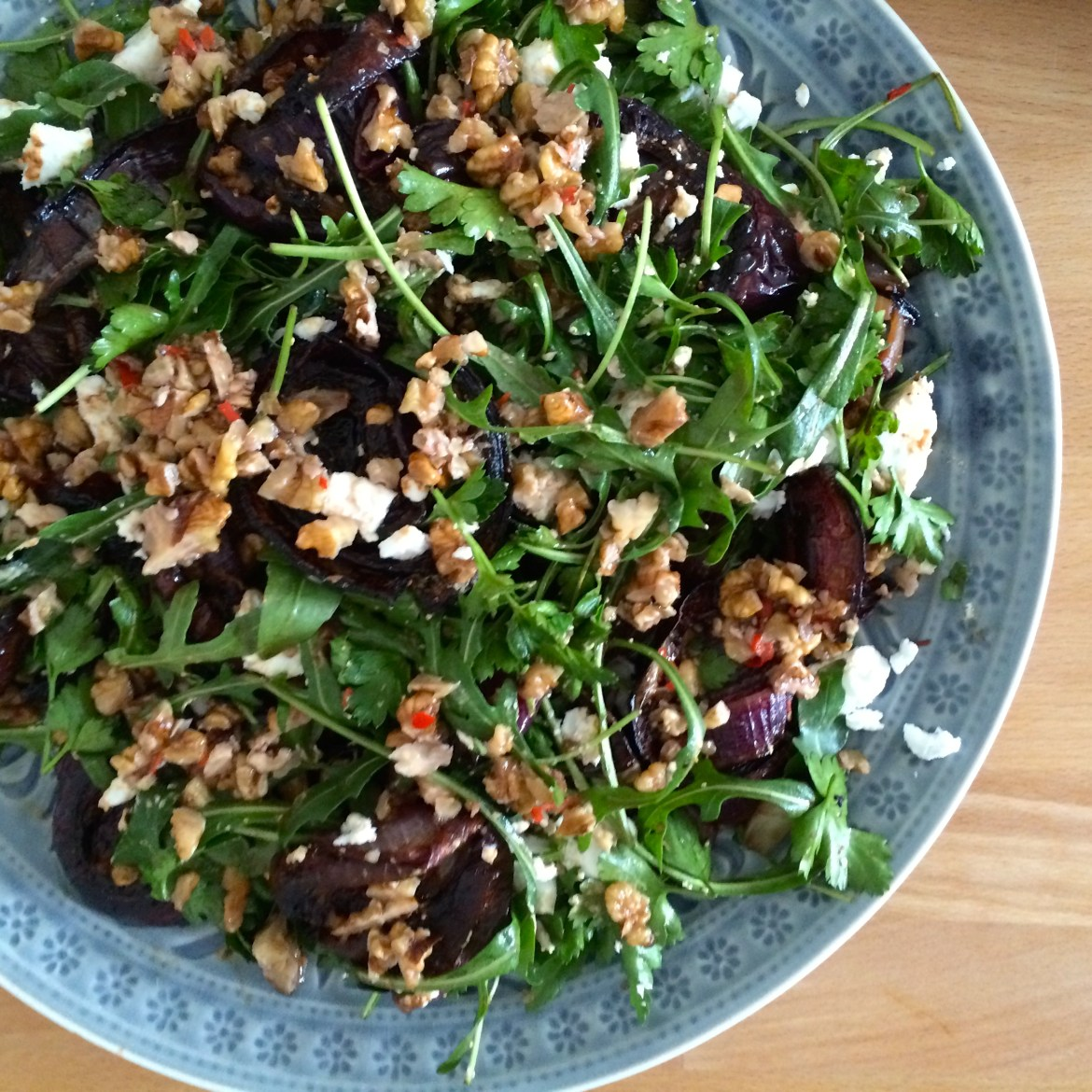 Ottolenghi's baked red onion, salad with walnut salsa
