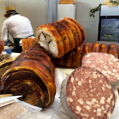 Stacks of porchetta and Italian meats