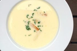 A bowl of white asparagus cream soup