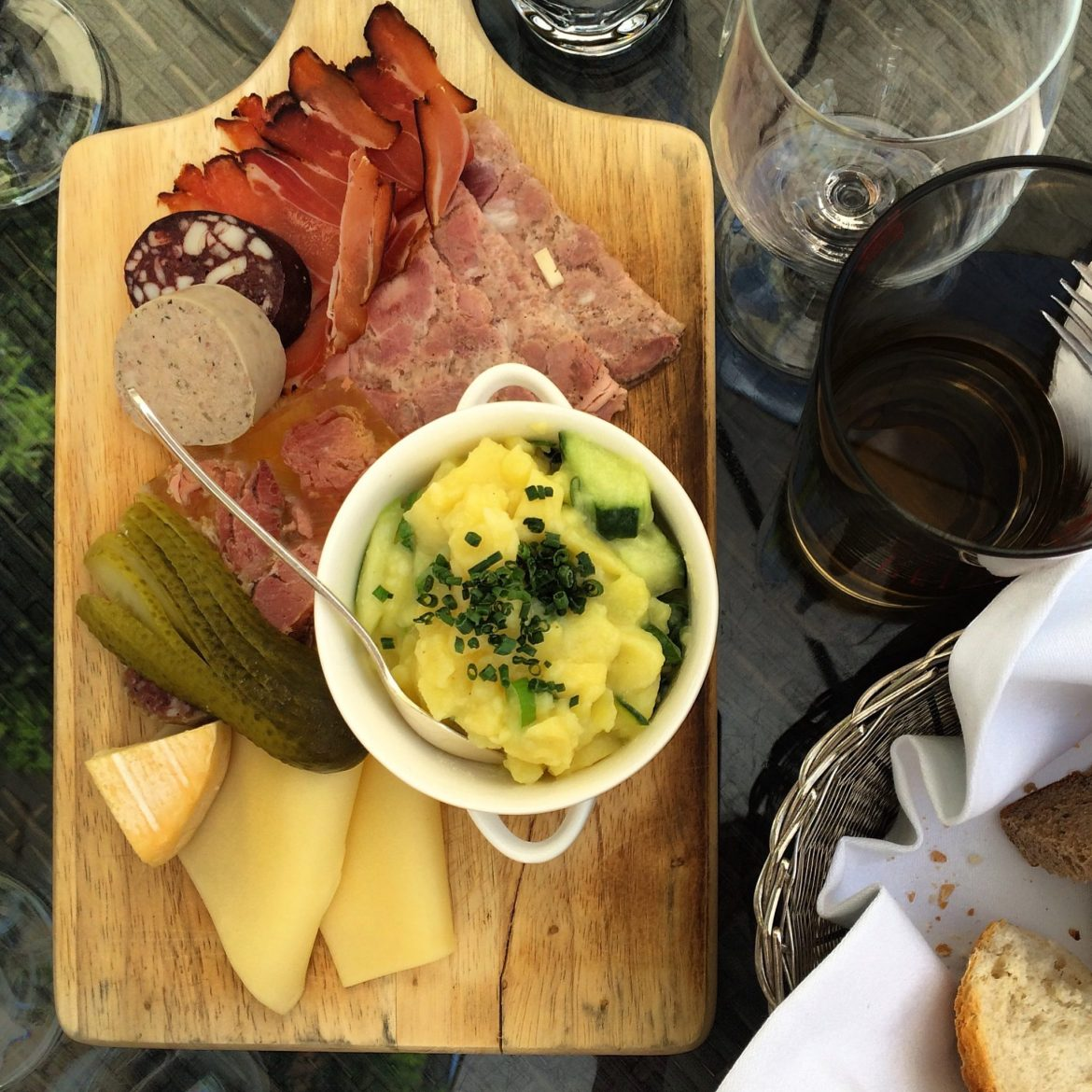 A tasting platter of meats and cheeses