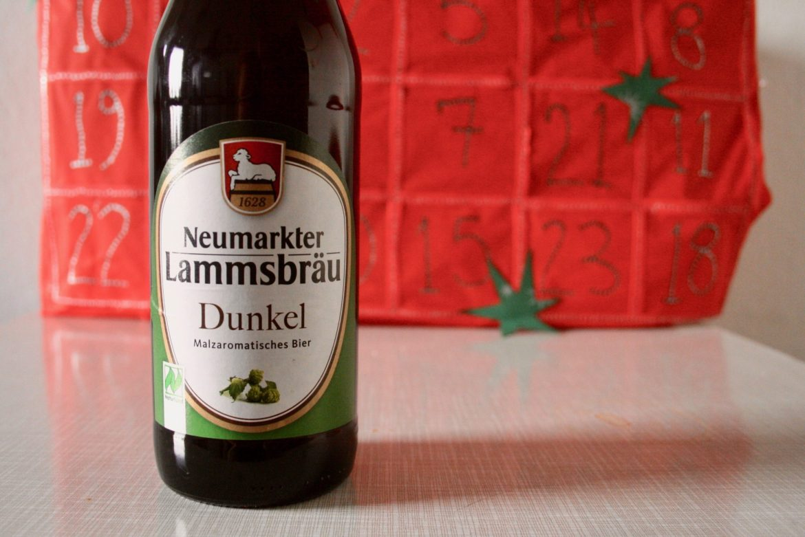 A bottle of German beer in front of a homemade beer Advent calendar (Lammsbräu Dunkelbier)