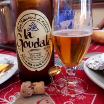 A bottle of beer and glass on a table