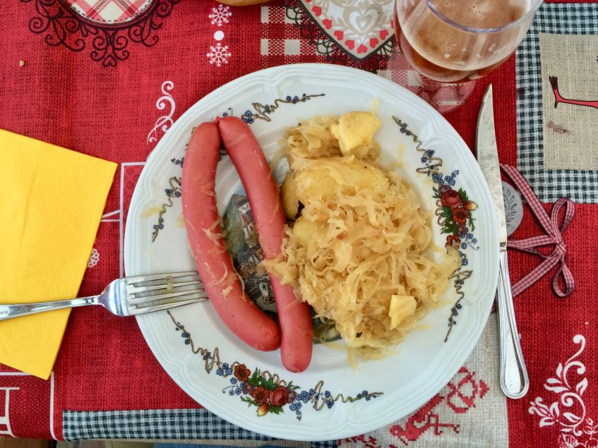 A plate of Choucroute and sausages in Alsace