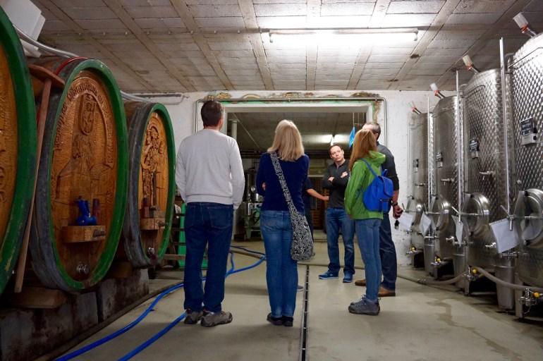 People in wine cellars in the Nahe region on a wine tasting tour