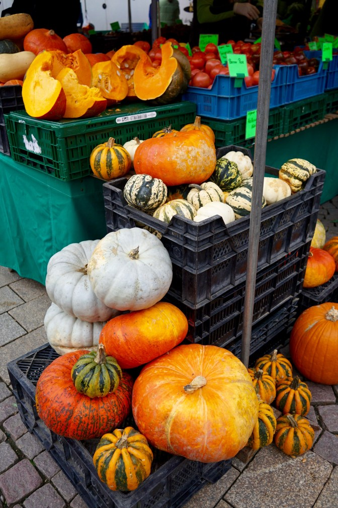 Pumpkins stacked on top of crates at the Wiesbaden farmers' market
