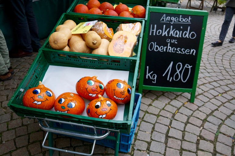 A German market stall selling painted pumpkins