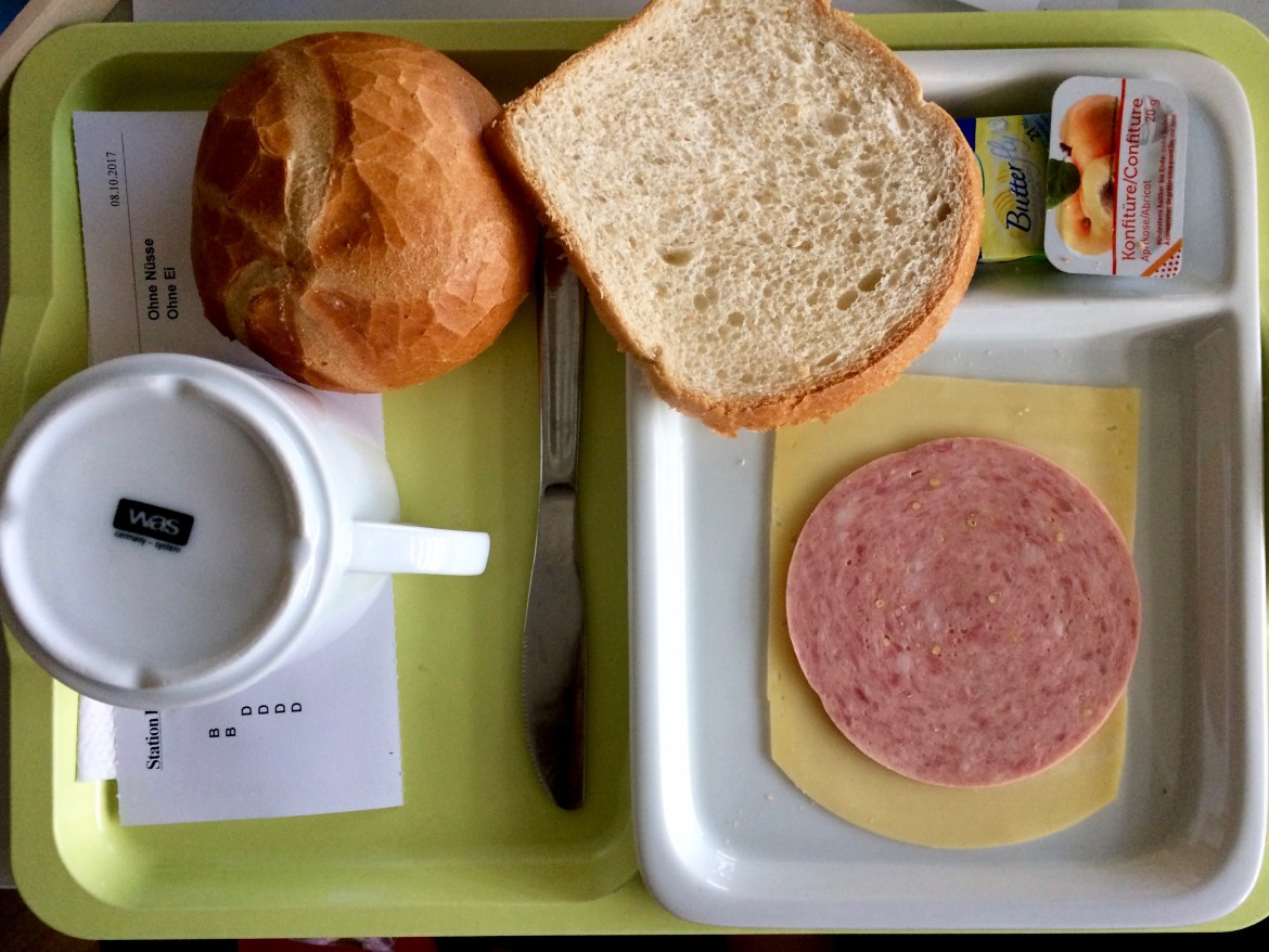 German hospital breakfast of meat, cheese and bread on a tray