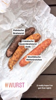 Three different German smoked pork sausages in their wrapping paper