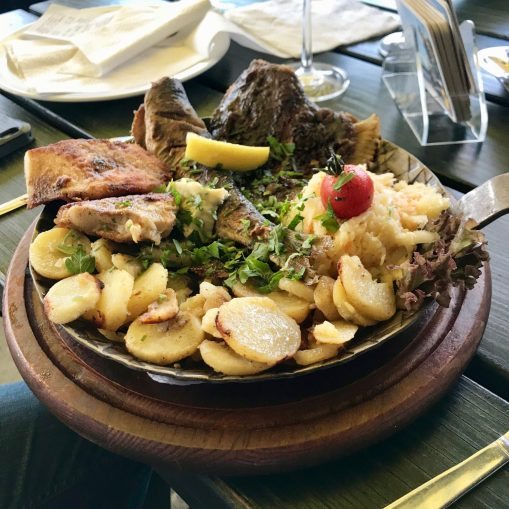 Catch of the day with fried potatoes and cabbage salad at Uwe's Fischhütte