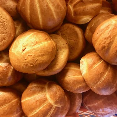 Shell-shaped German white bread rolls