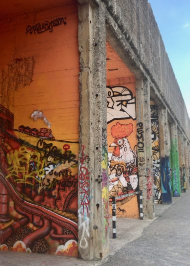 Brightly coloured graffiti on a disused building