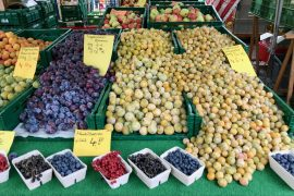A market stall overflowing with plums