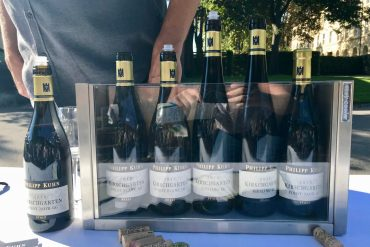 A glass display cabinet of German wines outside on a table