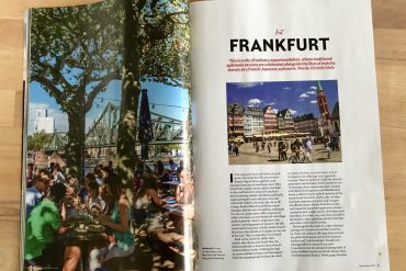 A magazine open on a double page spread about Frankfurt