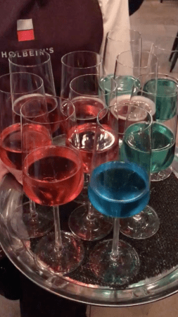 Brightly-coloured drinks on a tray