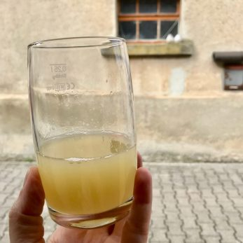 Fresh unfiltered pear juice in a glass