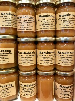 Stacked jars of manuka honey