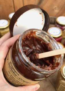 An open jar of chocolate honey